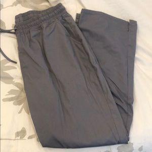 Skinny scrub pants. -JAANUU